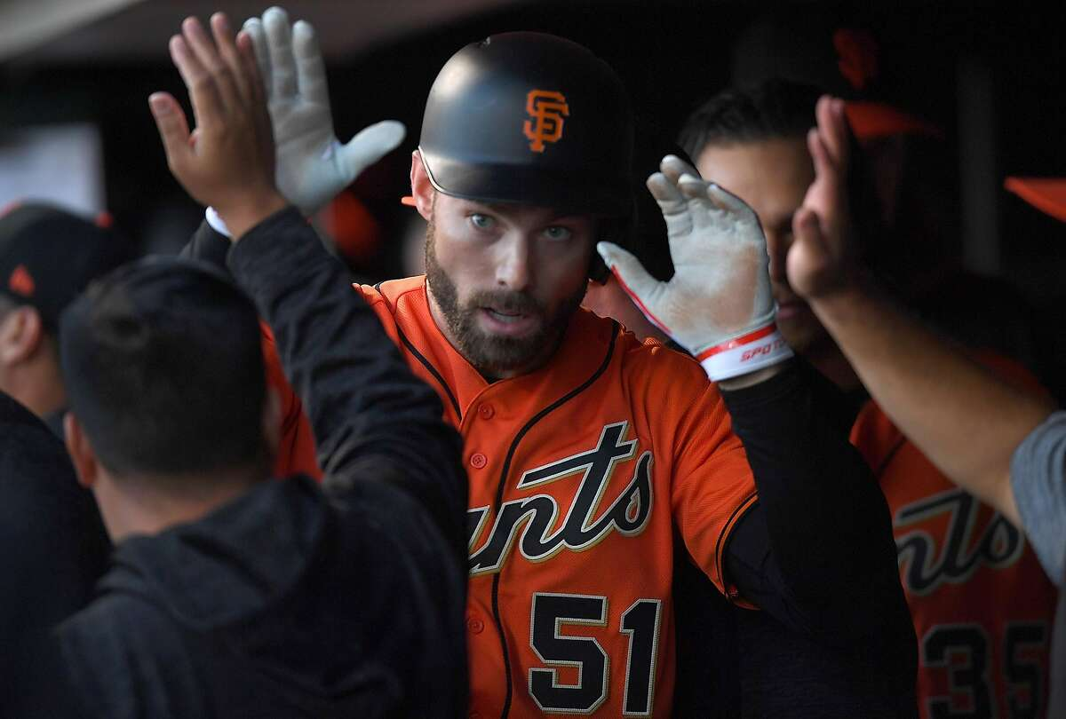 SAN FRANCISCO, CA - JUNE 01: Mac Williamson #51 of the San Francisco Giants is congratulated by teammates after Williamson scored against the Philadelphia Phillies in the bottom of the first inning at AT&T Park on June 1, 2018 in San Francisco, Californi