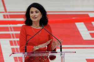 Renu Khator, University of Houston president, speaks after a surprise induction into the UH Athletics Hall of Honor along with Tilman Fertitta, chairman of the University of Houston System Board of Regents, during the opening celebration of the Fertitta Center at the University of Houston Thursday, Nov. 29, 2018, in Houston.