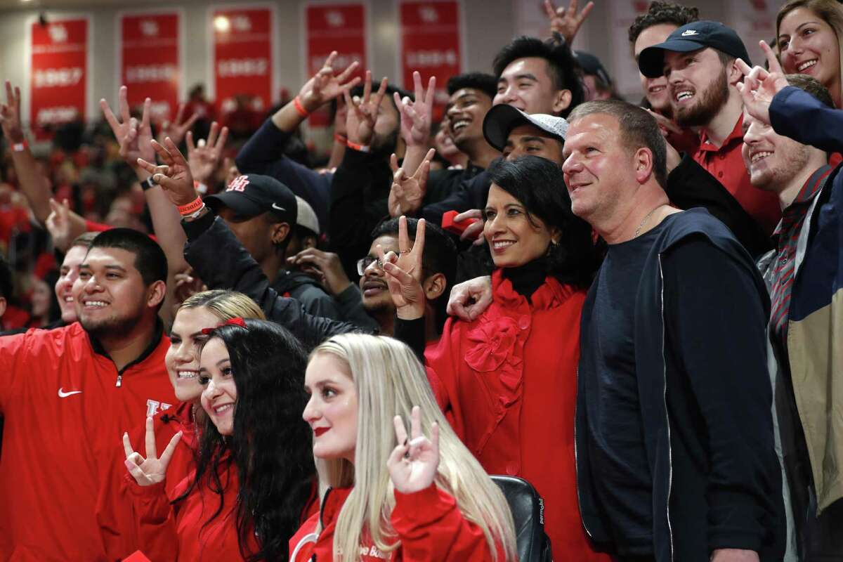 University of Houston President Renu Khator and Tilman Fertitta, chairman of the UH System Board of Regents, pose for photos with students at the Fertitta Center on Thursday, Jan. 31, 2019, in Houston.