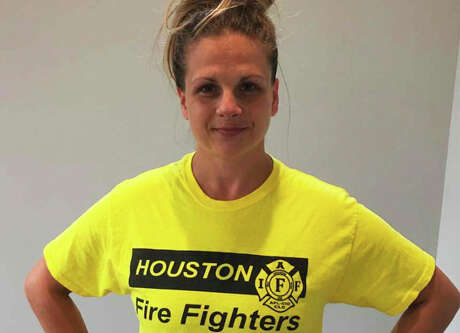 Jillian Ostrewich, who is married to a Houston firefighter, is pictured wearing the T-shirt she wore to a Harris County polling place for early voting in October 2018, when a pay parity measure for firefighters was on the ballot. According to court documents, election officials told her she could not cast her vote with the logo showing, so she turned her T-shirt inside out and was able to proceed.