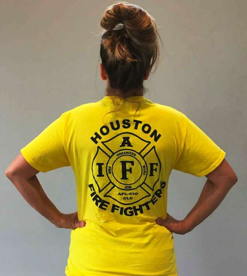 Jillian Ostrewich, who is married to a Houston firefighter, is pictured wearing the T-shirt she wore to a Harris County polling place for early voting in October 2018, when a pay parity measure for firefighters was on the ballot. According to court documents, election officials told her she could not cast her vote with the logo showing, so she turned her T-shirt inside out and was able to proceed. Photo: Credit: Pacific Legal Foundation. / handout