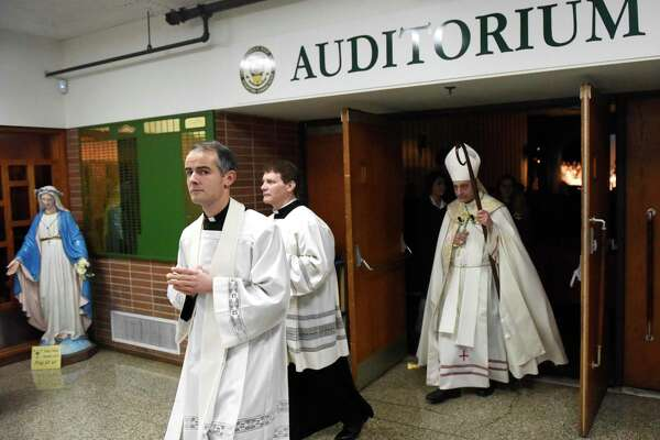 The Most Rev. Frank Caggiano, Bishop of the Diocese of Bridgeport, tours and blesses the new additions at Trinity Catholic High School in Stamford, Conn. Wednesday, Jan. 30, 2019. Bishop Caggiano spoke during the student and faculty prayer service featuring Bible passages and hymns and blessing of statues of the Virgin Mary and St. Thomas of Aquinas to protect the building and its students.