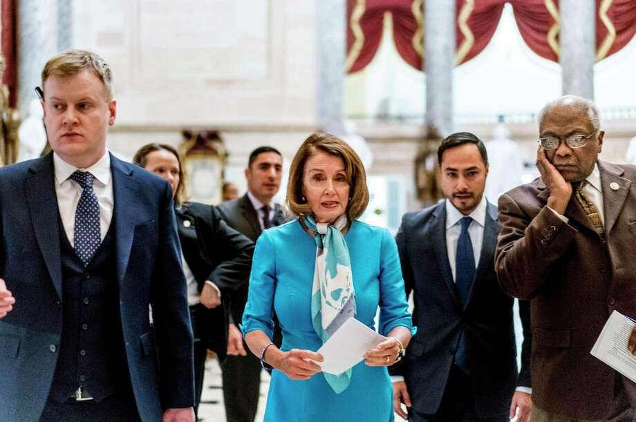 Speaker of the House Nancy Pelosi walks with Rep. Joaquin Castro, D-Texas, and House Majority Whip James Clyburn, D-S.C., into a news conference on Capitol Hill on Monday, Feb. 25, 2019. Photo: Washington Post Photo By Melina Mara. / The Washington Post