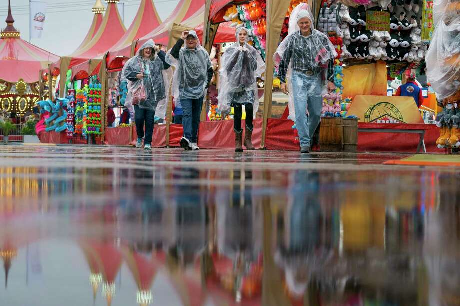 People navigate the carnival at the Houston Livestock Show and Rodeo on a rainy Thursday, Feb. 28, 2019. Photo: Mark Mulligan, Staff Photographer / © 2019 Mark Mulligan / Houston Chronicle