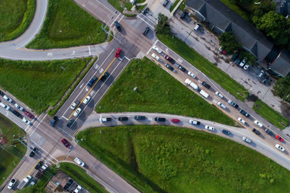 Traffic waits at the intersection of Mustang Road and the Texas 35 Alvin Bypass on Oct. 1. The bypass is expected to be the route of the planned segment of the Grand Parkway through Alvin.