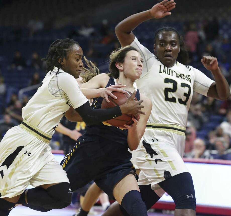 Pirette guard Kyrah Luna is squeezed in the lane at the end of a fastbreak by Telia Jackson, left, and Jordyn Beaty as Poth plays Woodville in the girls 3A state semifinal basketball game at the Alamodome on February 28, 2019. Photo: Tom Reel, Staff / Staff Photographer / 2019 SAN ANTONIO EXPRESS-NEWS