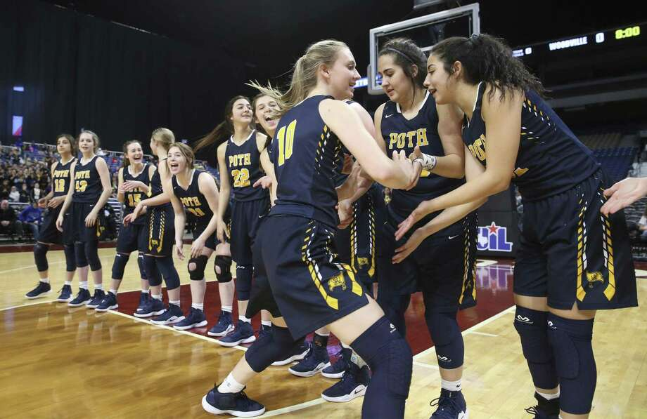 The Pirettes greet starter Morgan Pape during introductions as Poth plays Woodville in the girls 3A state semifinal basketball game at the Alamodome on February 28, 2019. Photo: Tom Reel, Staff / Staff Photographer / 2019 SAN ANTONIO EXPRESS-NEWS