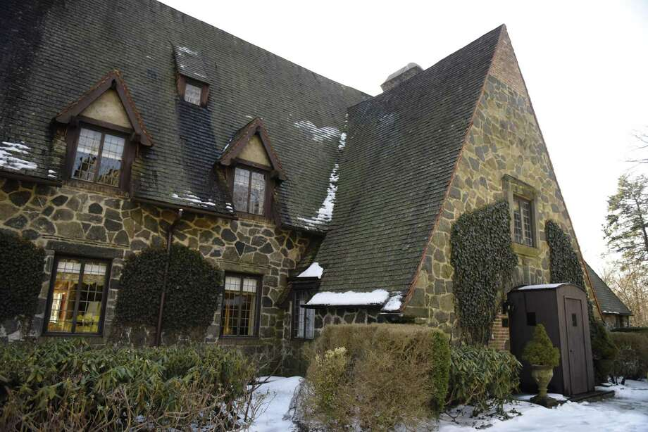 "File photo showing the historic ""Country Life House"" in the Khakum Wood Association, Connecticut's oldest housing association, in Greenwich, Conn. Photo taken on Thursday, Feb. 21, 2019. The nine bedroom, 8.3 bathroom English Manor-style home sits on Khakum Wood Lake and was built and staged as a model home to show life in the country in 1929. Photo: Tyler Sizemore / Hearst Connecticut Media / Greenwich Time"