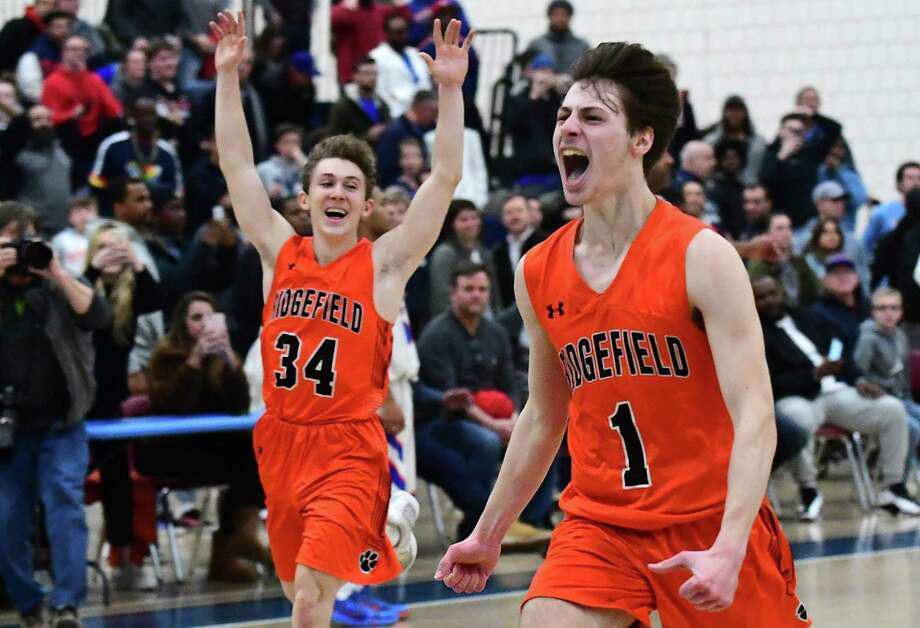 Ridgefield's James St. Pierre, left, and Joseph Misurelli celebrate after winning the FCIAC championship game against Danbury on Thursday. Photo: Erik Trautmann / Hearst Connecticut Media / Norwalk Hour