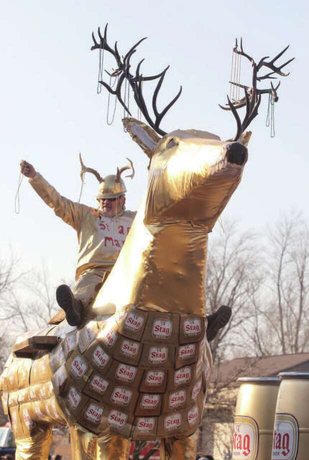 A golden man atop a golden deer was one of the last participants during a previous Wordi Gras parade in Worden. Photo: Scott Cousins | Hearst Media File Photo