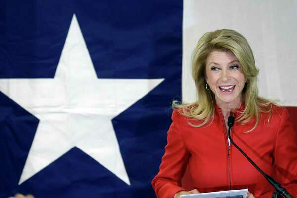 File - In this March 4, 2014 file photo, Texas Sen. Wendy Davis, D-Fort Worth, speaks to supporters at her campaign headquarters, in Fort Worth, Texas. Davis announced this week that she will run against U.S. Rep. Chip Roy. AP Photo/LM Otero, File)