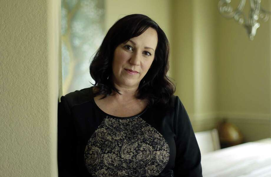 MJ Hegar poses for a portrait at her home in Round Rock, Texas, on Thursday, Aug. 9, 2018. Nine years after being shot down in Afghanistan, winning a lawsuit against the federal government, and writing a book, Hegar is now running for a Texas congressional seat. Women with military experience _ many of them combat veterans _ are among the record number of female candidates running for office this year. (AP Photo/Eric Gay) Photo: Eric Gay, STF / Associated Press / Copyright 2018 The Associated Press. All rights reserved.