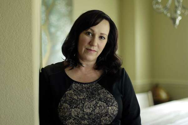 MJ Hegar poses for a portrait at her home in Round Rock, Texas, on Thursday, Aug. 9, 2018. Nine years after being shot down in Afghanistan, winning a lawsuit against the federal government, and writing a book, Hegar is now running for a Texas congressional seat. Women with military experience _ many of them combat veterans _ are among the record number of female candidates running for office this year. (AP Photo/Eric Gay)