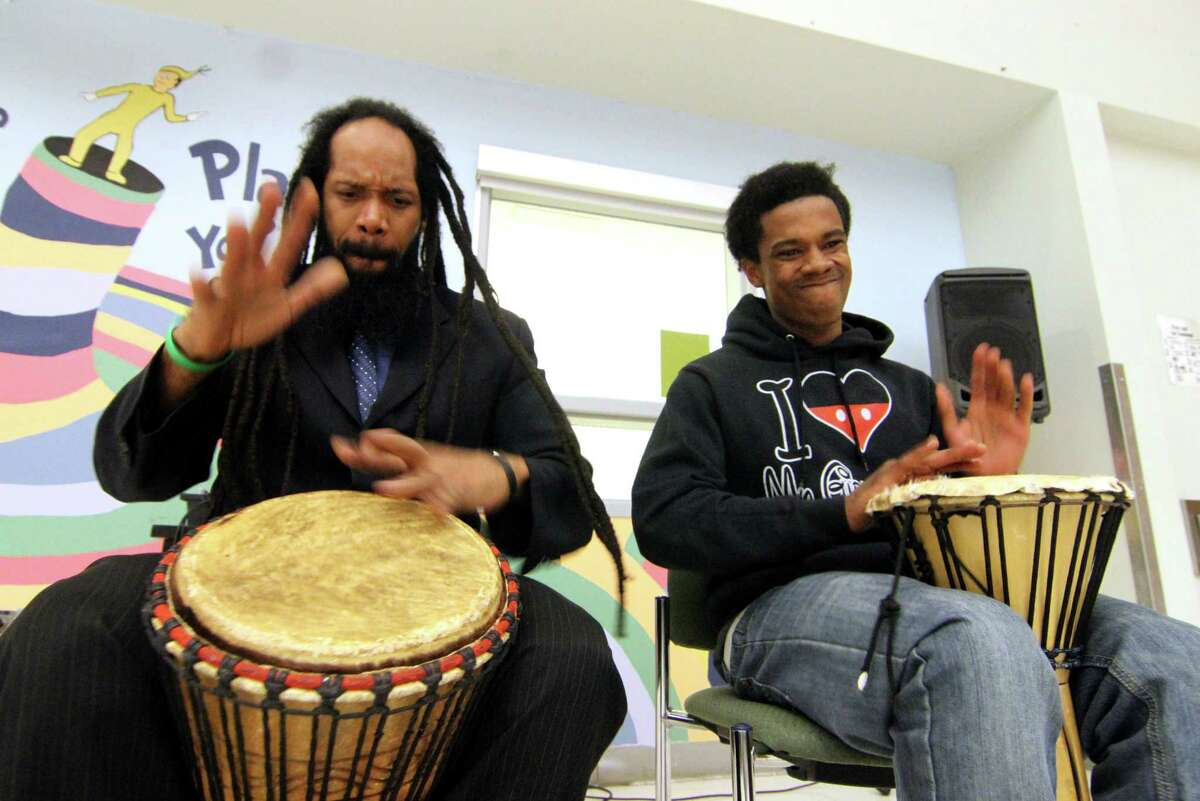 Gammy Moses, left, and Samuel Bowens play drums during Wexler Grant Community School's community dinner to celebrate the close of Black History Month in New Haven, Conn., on Thursday Jan. 28, 2019.. The dinner, sponsored by the Family Resource Center and Title I, is called