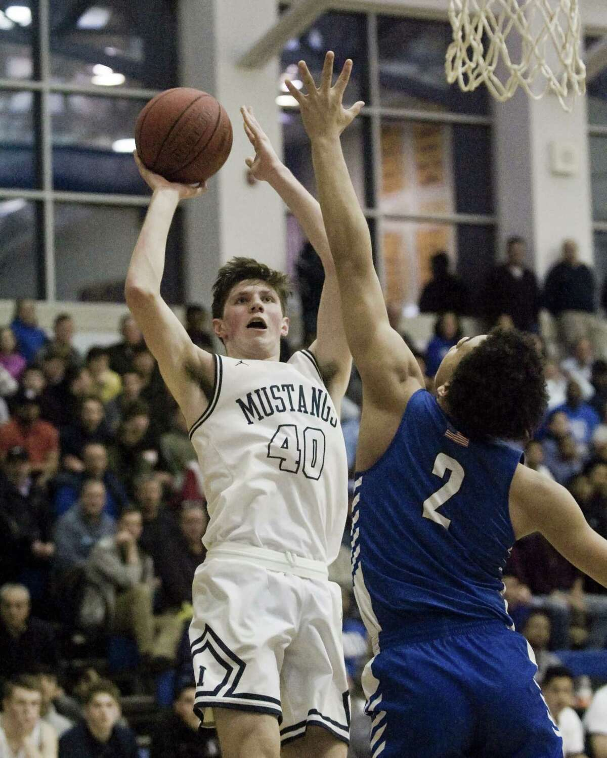Immaculate High School's Sean Guiry gets off a shot in the SWC championship boys basketball game against Bunnell High School, played at Newtown High School. Thursday, Feb. 28, 2019