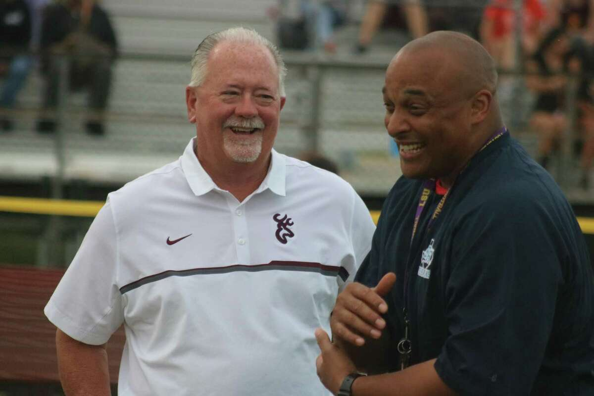 Fortunately, outgoing Sam Rayburn High School head football coach Shaun Wynn never lost his sense of humor as he and former Deer Park head coach Chris Massey share a laugh while at a track meet.