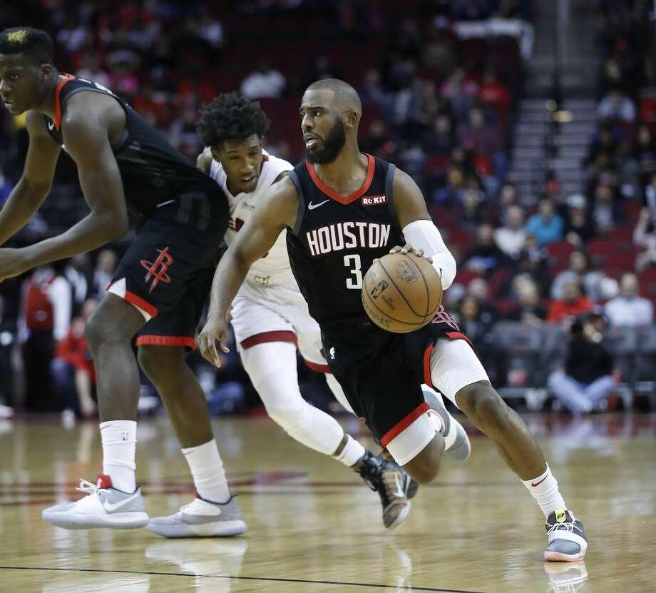 eb036770b593 Houston Rockets guard Chris Paul (3) cuts around Miami Heat guard Josh  Richardson (