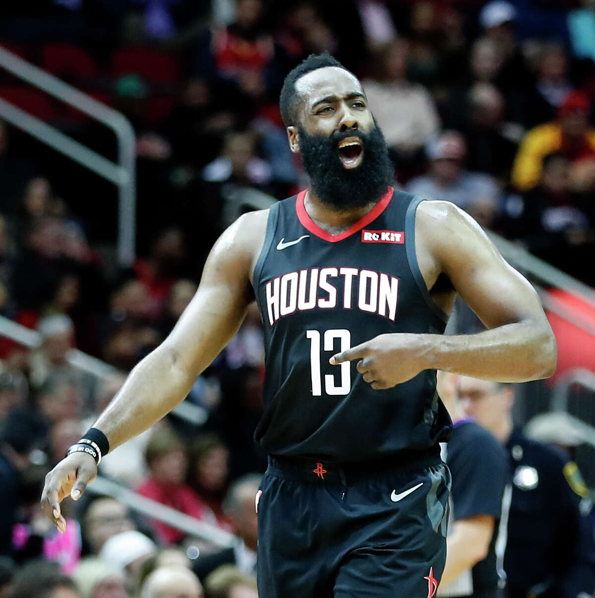 Houston Rockets guard James Harden (13) tries to get the crowd fired up during the second half of an NBA game at Toyota Center, Thursday, Feb. 28, 2019, in Houston.