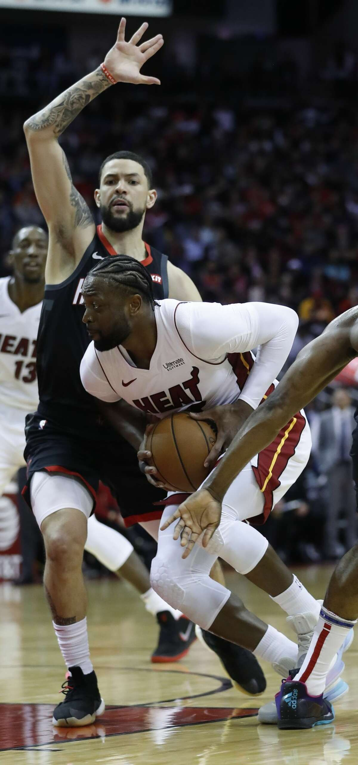 Miami Heat guard Dwyane Wade (3) goes up against Houston Rockets guard Austin Rivers (25) under the basket during the second half of an NBA game at Toyota Center, Thursday, Feb. 28, 2019, in Houston.