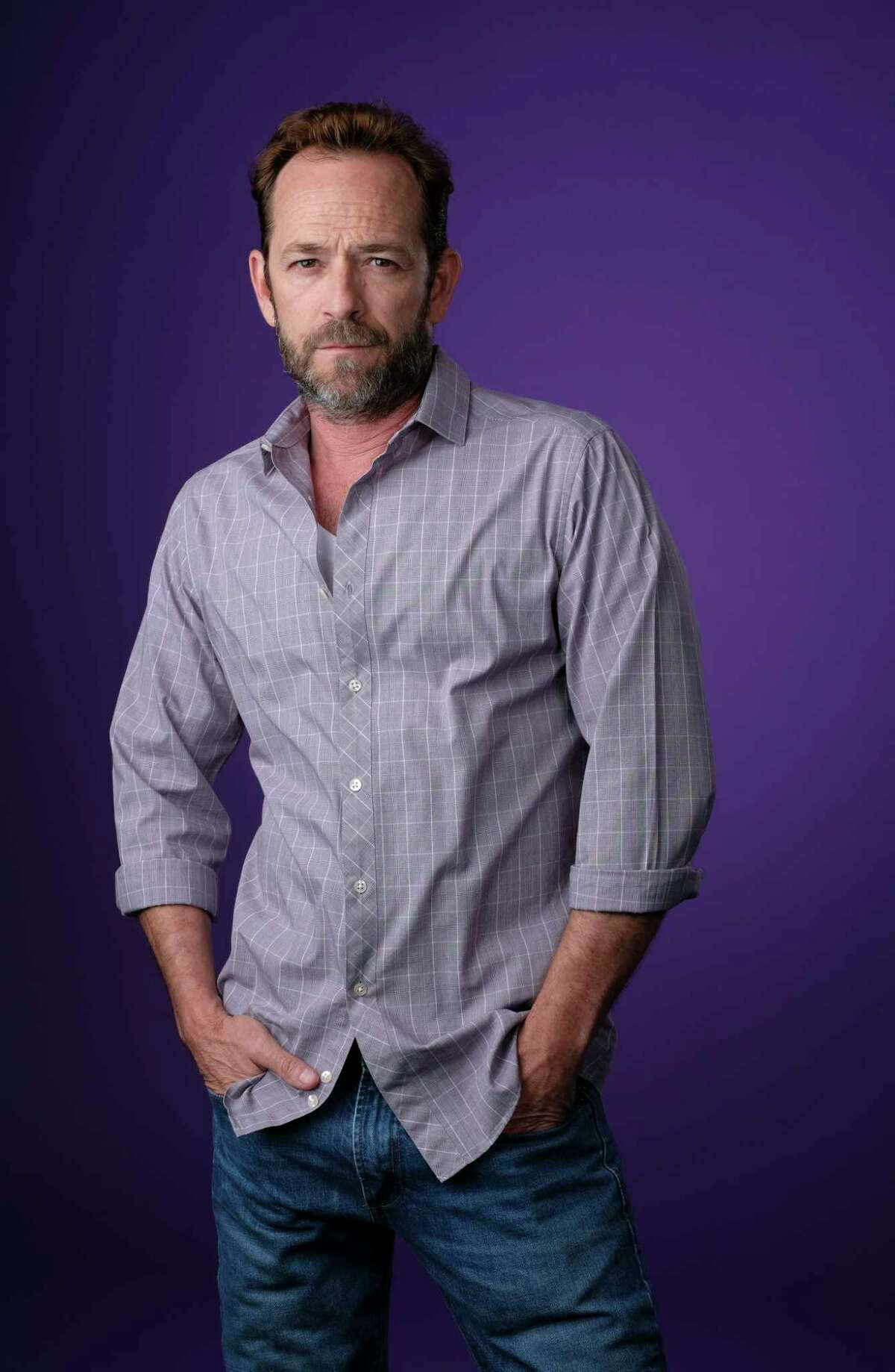 """FILE - In this Aug. 6, 2018, file photo, Luke Perry, a cast member in the CW series """"Riverdale,"""" poses for a portrait during the 2018 Television Critics Association Summer Press Tour in Beverly Hills, Calif."""
