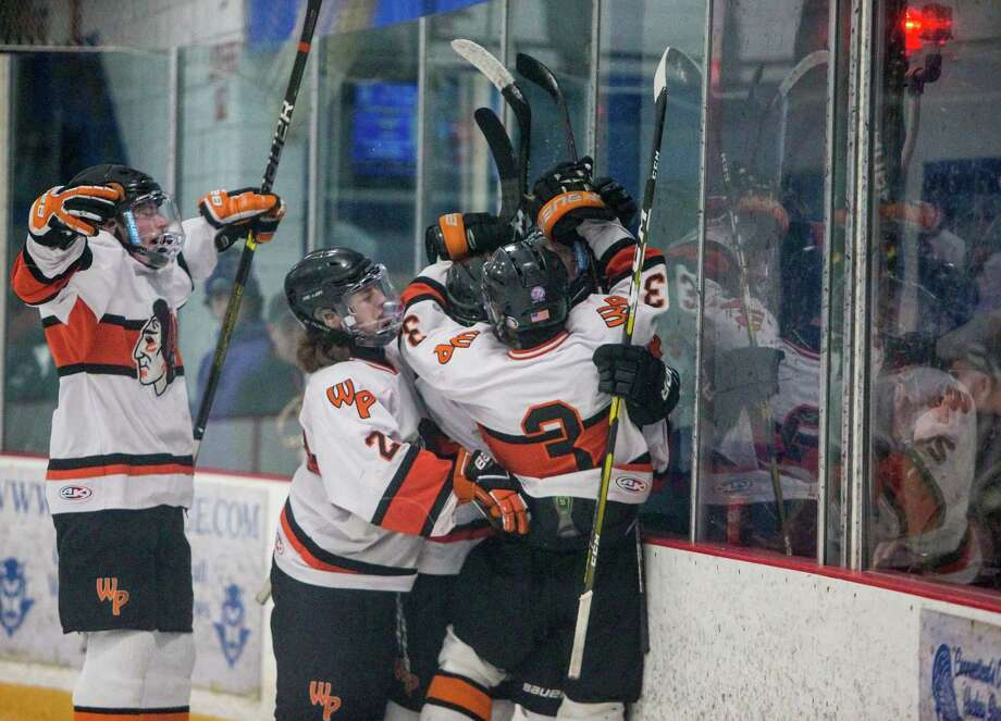 Members of the Watertown/Pomperaug boys hockey team celebrate a second-period goal by Sean Dunfee. Photo: John Vanacore /For Hearst Connecicut Media / (c)John H.Vanacore