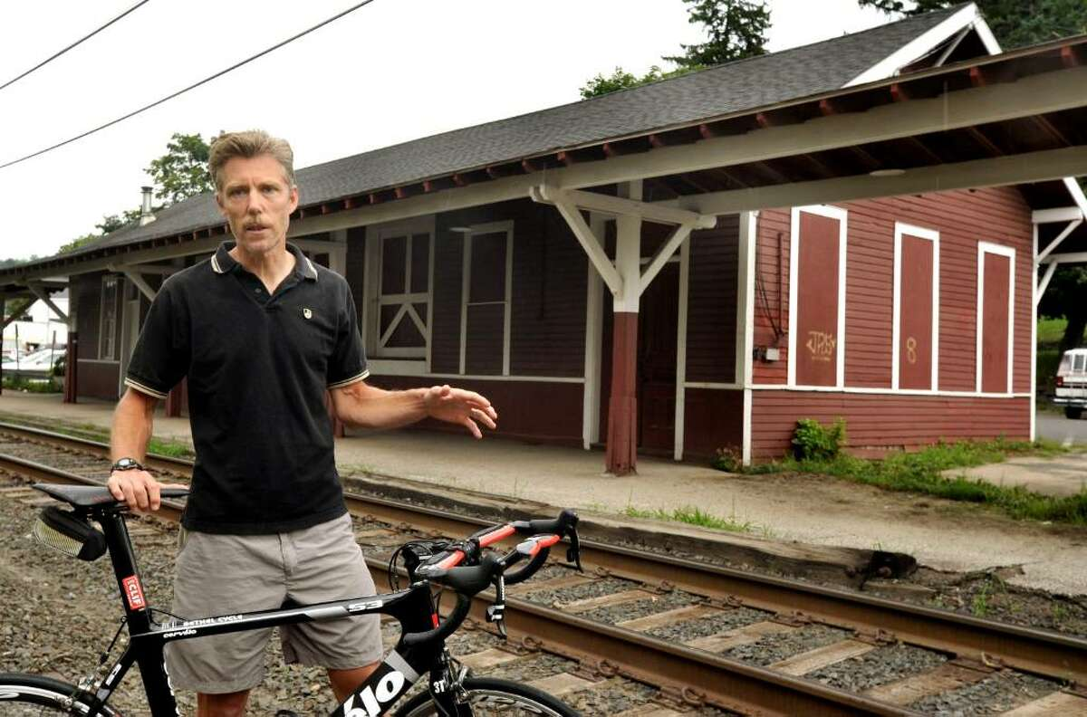 Greg Pelican talks about plans to move his Bethel Cycles shop from Greenwood Avenue to the old Bethel train station, Friday, July 23,2010.