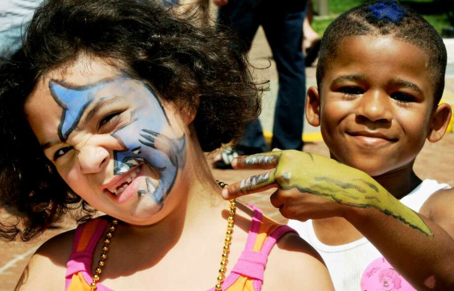 L-R: Mackylie Race, age 6, of Hudson and her 7 year old cousin, Dejawn Crooks, of Albany, show off their face paints they received at GE Kids Day  on Sunday, July 18, 2010, at the Empire State Plaza in Albany, NY.  Race has a shark on her face, while Crooks sports an alligator on his arm.  The General Electric sponsored event treated children to bouncy bounce setups, food, a petting zoo, pony rides, crafts, characters to meet & face painting for the day.       (Luanne M. Ferris / Times Union) Photo: LUANNE M. FERRIS