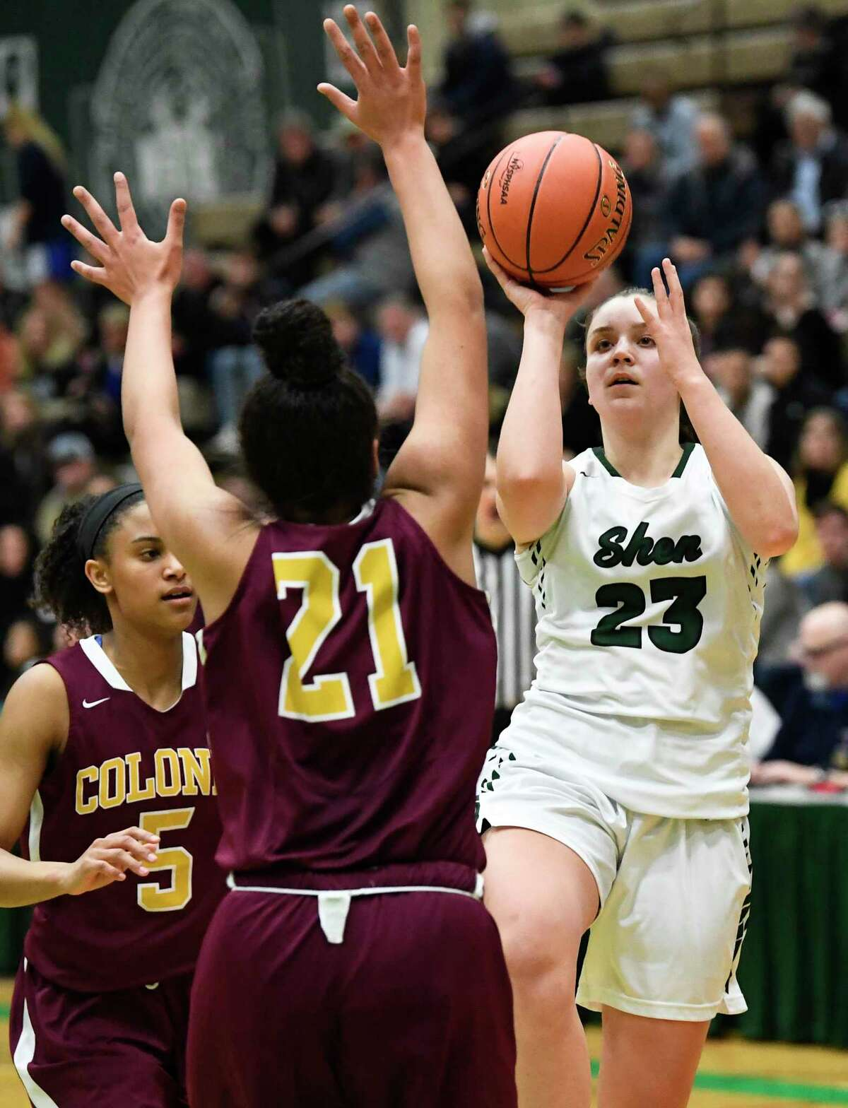 Shenendehowa's Meghan Huerter (23) scores against Colonie's Sareena Dicerbo (21) during a Section II Class AA Girls' semifinal high school basketball game Thursday, Feb. 28, 2019, in Troy, N.Y. Shenendehowa won 62-50. (Hans Pennink / Special to the Times Union)