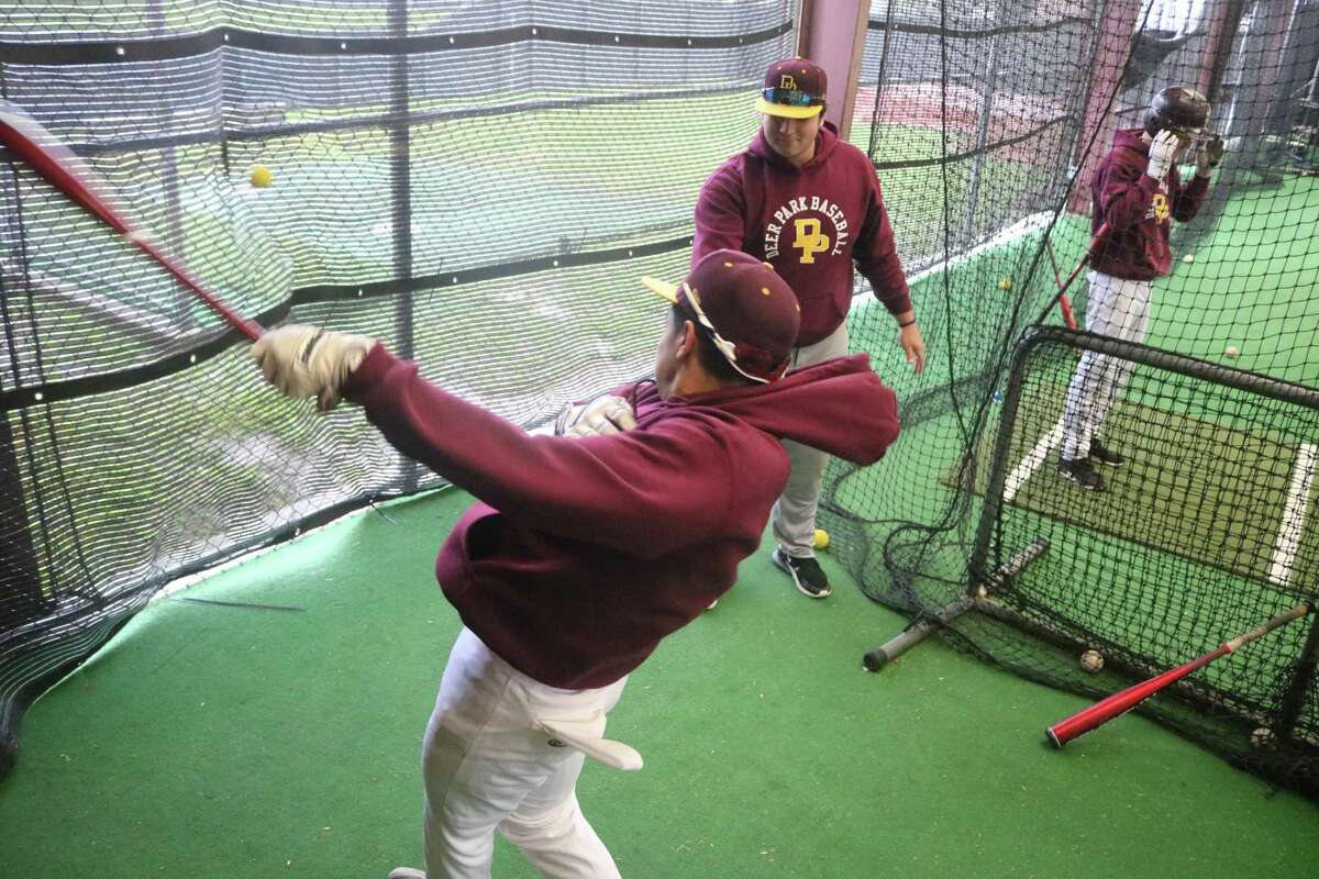 Noah Ramirez hits practice balls into the side of the team's batting cages Thursday afternoon. Joining him is Alex Olivo. it was just another day the club couldn't get on Jim Kethan Field's diamond because of more rainy weather. So far, six Deer Park games have been rained out.