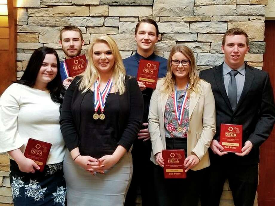 SVSU students, from left, Maggie Walker, Jacob Saint Amour, Madisyn Nicol, Keegan Booms, Carly D'Alessandro and Brady Wieland competeat the Michigan Collegiate DECA competition. (Photo provided/ SVSU)