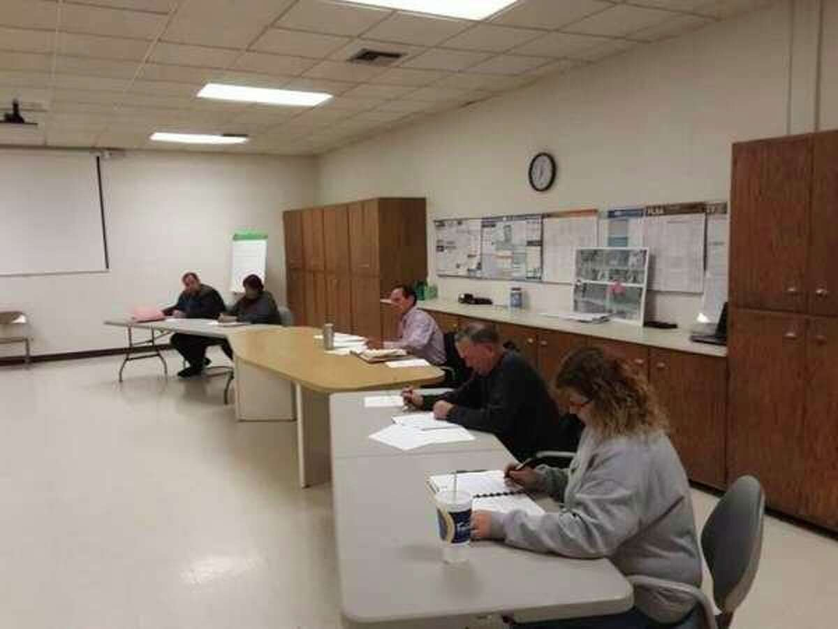 FILE -- The Mills Township Board of Trustees prepares to address questions and concerns regarding an alleged misuse of fundsduring a special meeting on Oct. 23, 2018. (John Kennett/Daily News File)