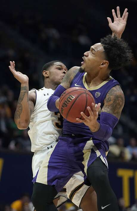 Washington guard David Crisp drives to the basket against California guard Paris Austin (3) during the first half of an NCAA college basketball game Thursday, Feb. 28, 2019, in Berkeley, Calif. (AP Photo/Tony Avelar) Photo: Tony Avelar, Associated Press