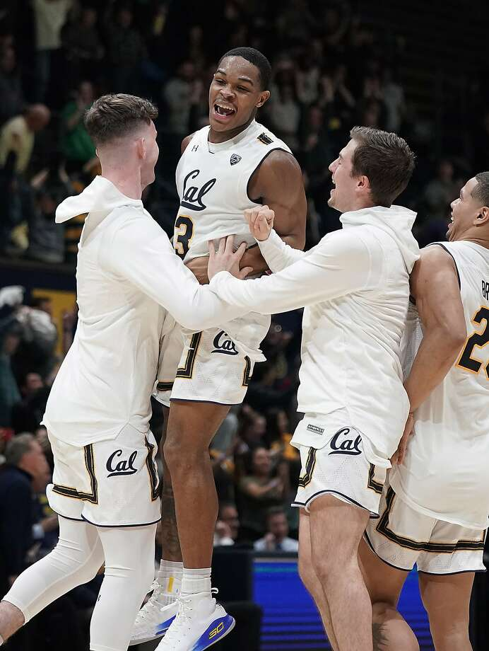Cal's Paris Austin leaps while celebrating with teammates after the Bears ended their 16-game losing streak. Photo: Tony Avelar / Associated Press