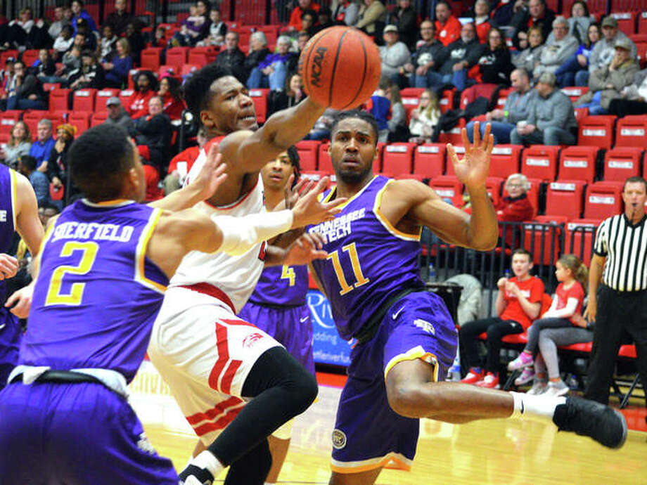 SIUE's Elochukwu Eze, middle, drives to the basket during Thursday's game against Tennessee Tech at Vadalabene Center. Photo: Scott Marion/Intelligencer