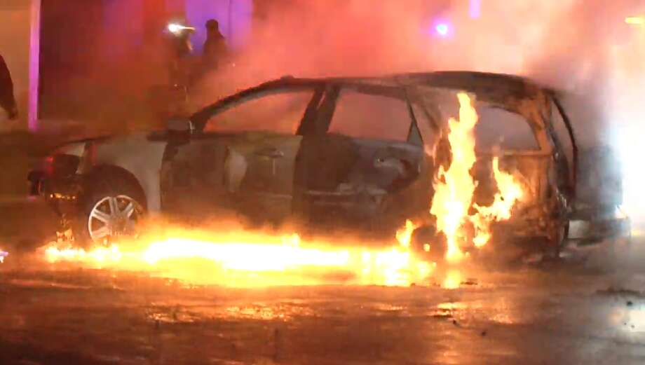 A man's vehicle burst into flames after a crash in southeast Houston. He was tested for possible DWI on the scene. Photo: Metro Video