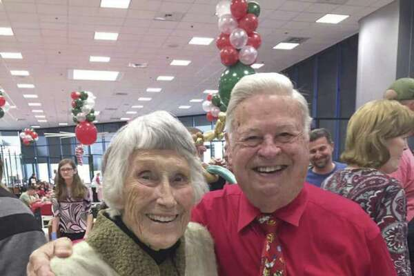 Dolly and Tony Gullo Sr. look forward each year to making Christmas extra special for children. (Photo courtesy of Gullo Ford)