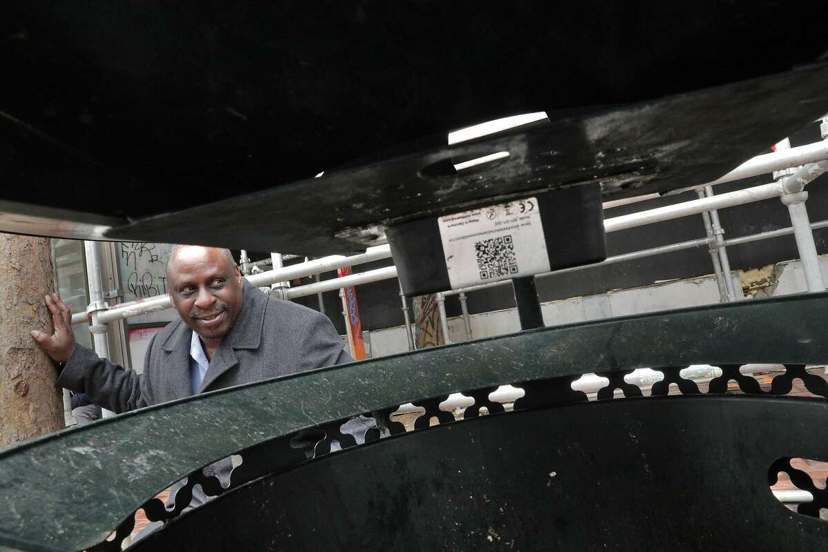 Larry Stringer, Deputy Director of Operations for Public Works, next to a garbage can which has been outfitted with a capacity sensor on Market Street in San Francisco, Calif., on Wednesday, February 27, 2019. San Francisco is installing computer sensors in public trash cans that send a signal when the cans are nearing capacity and crews are dispatched to empty the cans before they overflow.