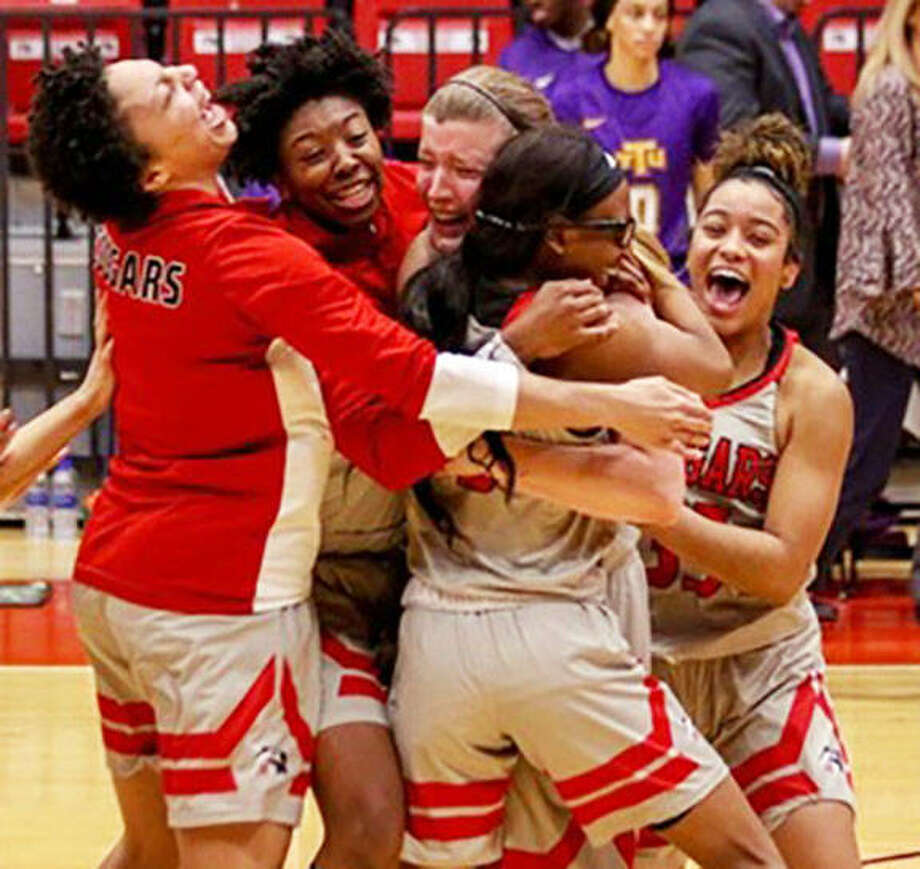 Members of the SIUE women's basketball team celebrate after rallying from a 16-point deficit in the second half to beat Tennessee Tech on Thursday night at Vadalabene Center in Edwardsville.