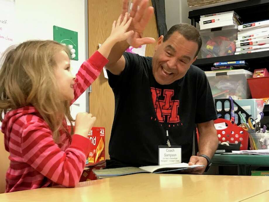 Houston basketball coach Kelvin Sampson reads to students at the University of Houston Charter School on Friday as part of Read America Day. Photo: Joseph Duarte/Houston Chronicle
