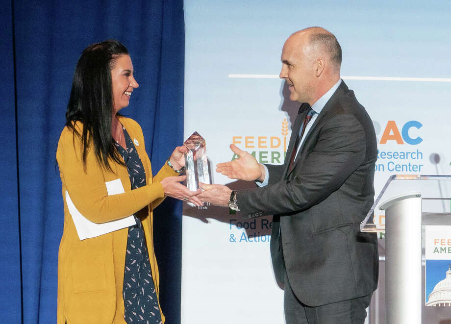West Texas Food Bank executive director Libby Campbell receives the Dick Goebel Award from Matt Knott, president of Feeding America, on Monday in Washington D.C. Photo: Courtesy Photo
