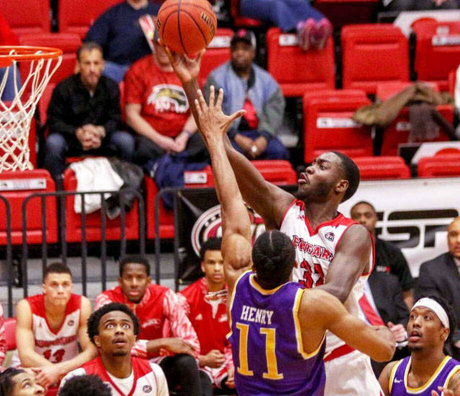 SIUE's Brandon Jackson shoots over Tennessee Tech's Micaiah Henry (11) during the Cougar's OVC victory on Thursday night at Vadalabene Center in Edwardsville.