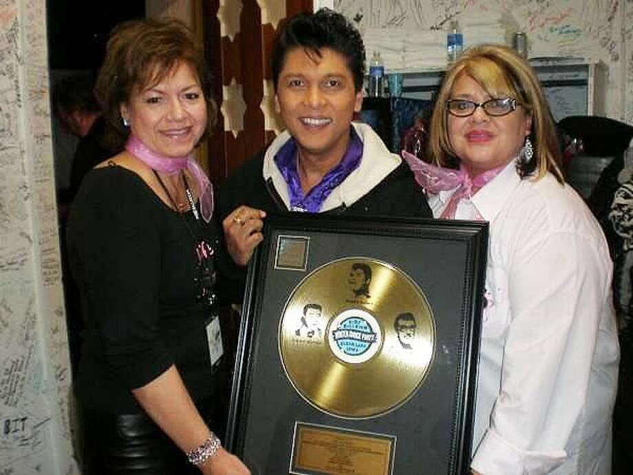 Connie and Irma Valenzuela, sisters to Ritchie Valens, join Sting Ray Anthony for a photo. The sisters appreciate the tribute show done by Anthony. Photo: Submitted