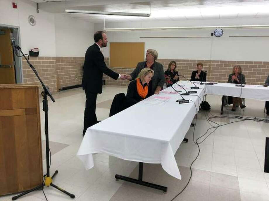 District 7 Board Member Jill Bertels congratulates Jason Henderson on being named Edwardsville District 7's new superintendent, effective July 1. Photo: Photos By Julia Biggs | The Intelligencer