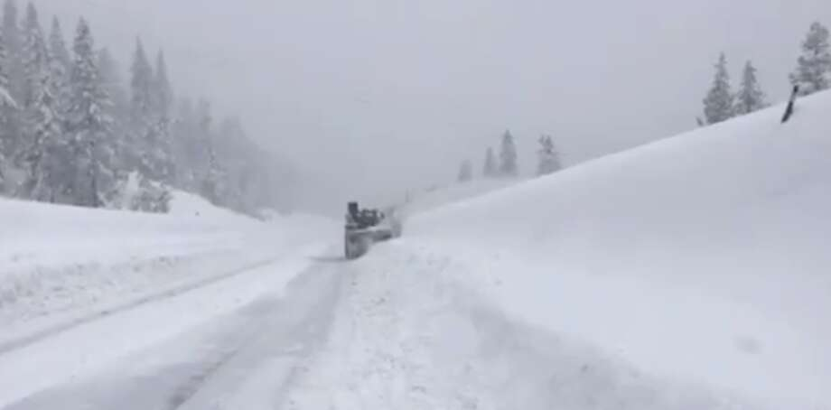 """FILE PHOTO: Snowplow at work on Interstate 80 over Donner Pass on Feb. 26, 2019. Caltrans District 3 tweeted, """"Even though I-80 is currently closed our Sierra Snowfighters are still out clearing highways. A huge shoutout to these men and women who work around the clock during all weather conditions."""" Photo: Caltrans"""
