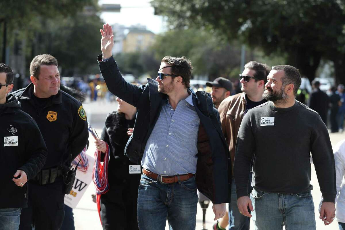U.S. Representative for Texas's 2nd congressional district Dan Crenshaw walks in the13th Annual MLK Youth Parade Saturday, Jan. 19, 2019, in Houston.