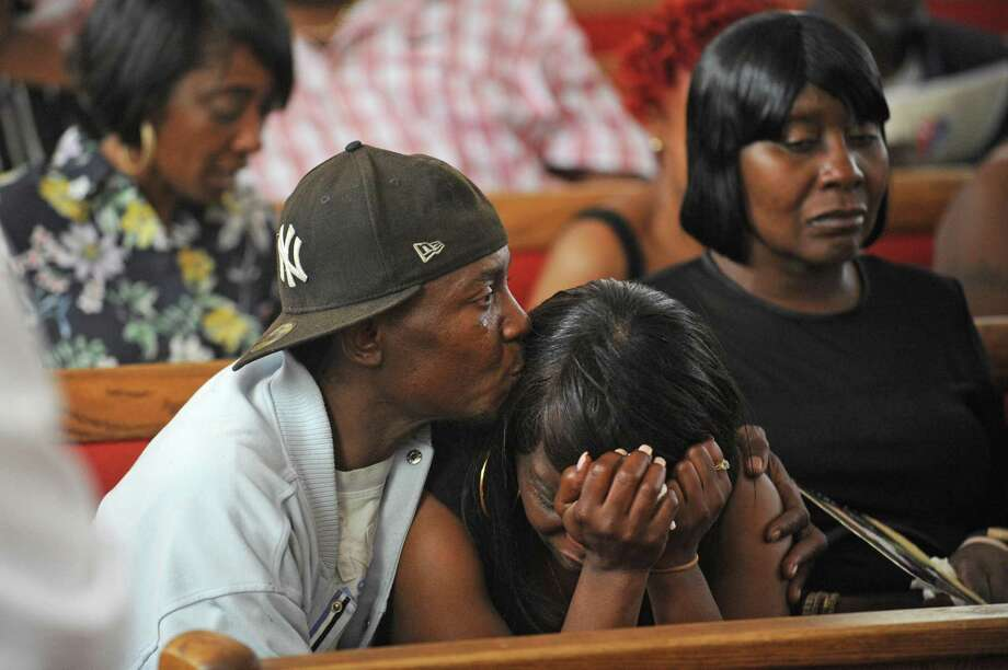 Sean Smith consoles Michelle Warren, the mother of 18-year-old Antonio Robinson, during his funeral inside the Faith Tabernacle Missionary Baptist Church in Stamford, Conn. on Thursday, June 14, 2018. Robinson was shot and killed two weeks before his high school graduation on West Avenue on May 30, 2018. Photo: Michael Cummo / Hearst Connecticut Media / Stamford Advocate