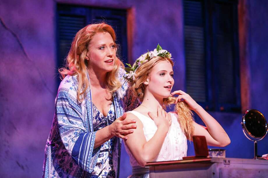 "Sally Wilfert as ""Donna"" and Berklea Going as ""Sophie"" in the current production of ""Mama Mia"" at TUTS. Photo: Photo By Melissa Taylor"