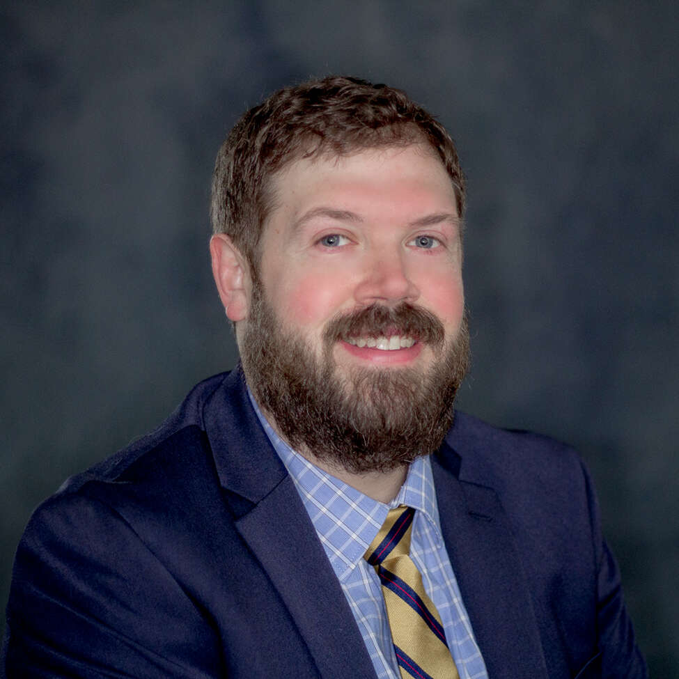 Neil Corkery, 38, joined Roohan Realty about two years ago. Unlike many of his peers, Corkery doesn't make use of personal social media accounts, favoring direct contact with clients.