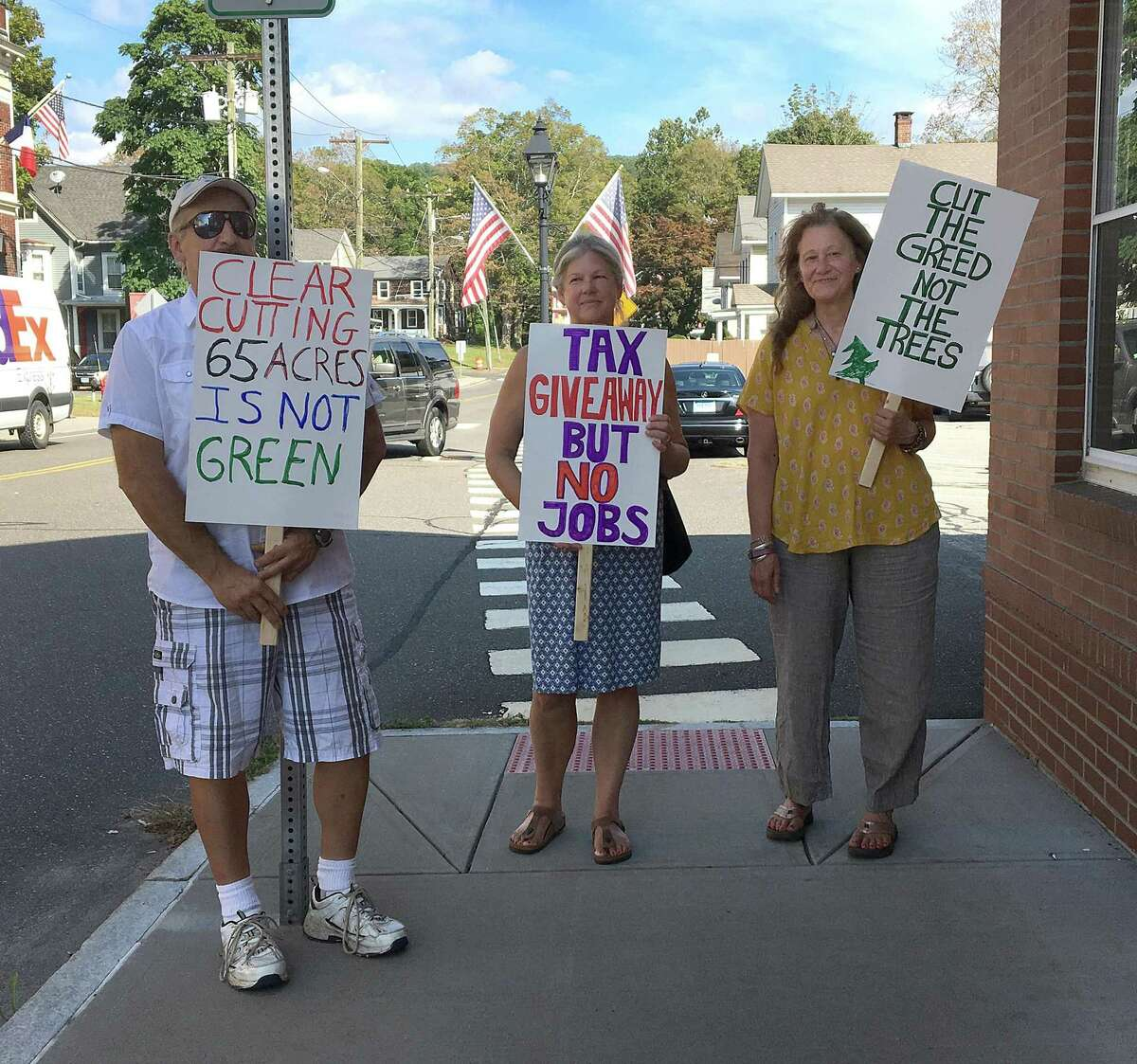 Protesters were present outside of the New Milford Town Hall in 2017 where a meeting regarding solar panels on Candlewood Mountain was taking place.