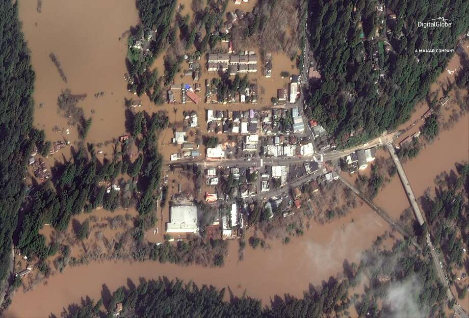This Thursday, Feb. 28, 2019 satellite image provided by DigitalGlobe shows The Russian River flooding Guerneville, Calif.   The storm-swollen river is slowly receding after causing extensive flooding, but more rainfall is expected Friday night and Saturday. (DigitalGlobe, a Maxar company via AP) Photo: Associated Press